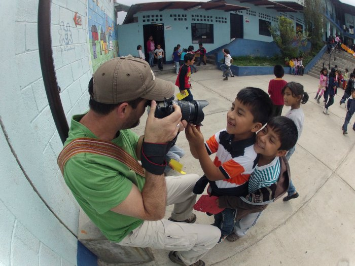 Scott Umstattd photographing students at a school in Ciudad Vieja, Guatemala